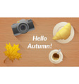 hallo autumn text tasty buttery croissant and cup vector image