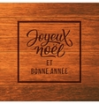 Joyeux Noel text wood Christmas greeting card vector image