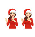 surprised woman pointing in santa hat vector image vector image