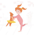 a little girl playing with a cat vector image vector image