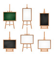 different colored blank boards standing on easels vector image vector image