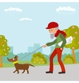 Elderly man walking with his dog in the park vector image