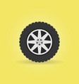 flat car wheel with tire icon on yellow vector image vector image