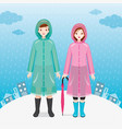 male and female traveller wearing raincoats vector image vector image