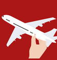 hand holding airplane toy symbol concept of travel vector image vector image