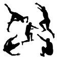 silhouettes of men jumping vector image