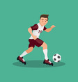 football player kicks the ball vector image