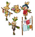 set of scarecrow straw toys and drying clothes vector image vector image