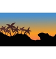 Silhouette of palm on the hills vector image vector image