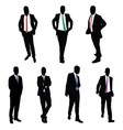 A collection of 7 businessman silhouettes vector image