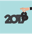 hand changing 2017 to 2018 vector image vector image