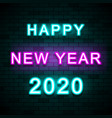 2020 happy new year on brick wall background