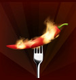 Red chilli pepper with a fork on fire
