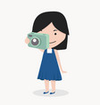 smiling little girl take a photograph vector image vector image