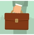 businessmans hand holding briefcase vector image vector image