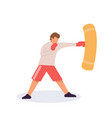 man in boxer gloves exercising with punching bag vector image vector image