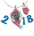 small dog in santa claus hat sitting vector image vector image