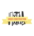 under construction on yellow ribbon with black vector image