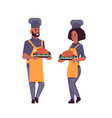 cooks couple professional chefs holding trays vector image vector image