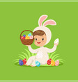 cute little boy in a white bunny costume holding vector image vector image